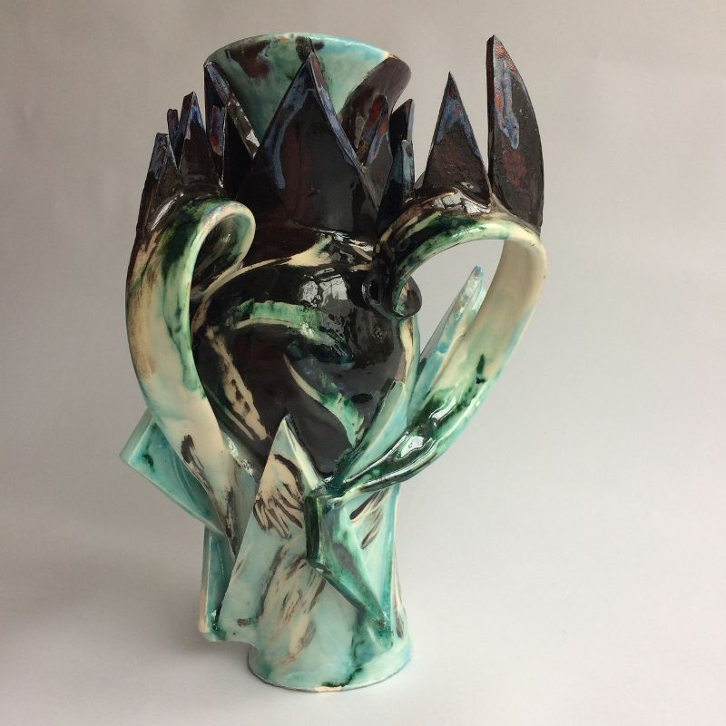 Grecian shaped ceramic vase. Spikes and curves. Colourful and glazed. Collectible pottery from an emerging British artist.