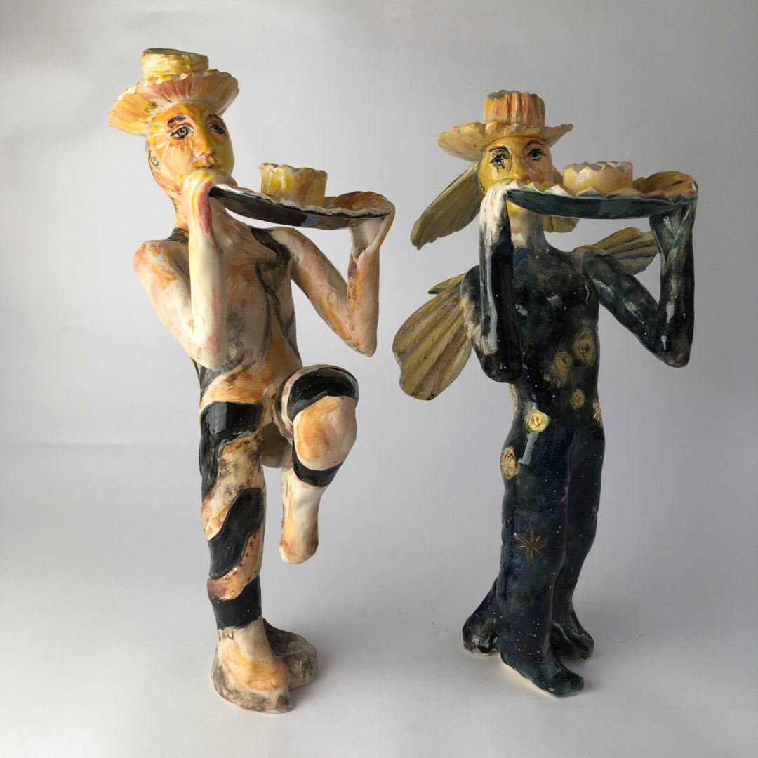 Moth people made in ceramics as candle sticks